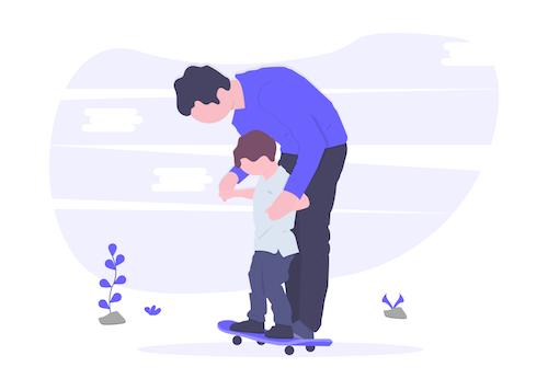 父親が子どもにスケボーを教える画像